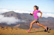 Female running athlete. Woman trail runner sprinting for success